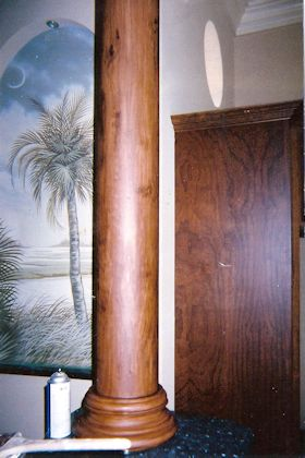 Faux Wood Grain Column with Painted Mural in Background